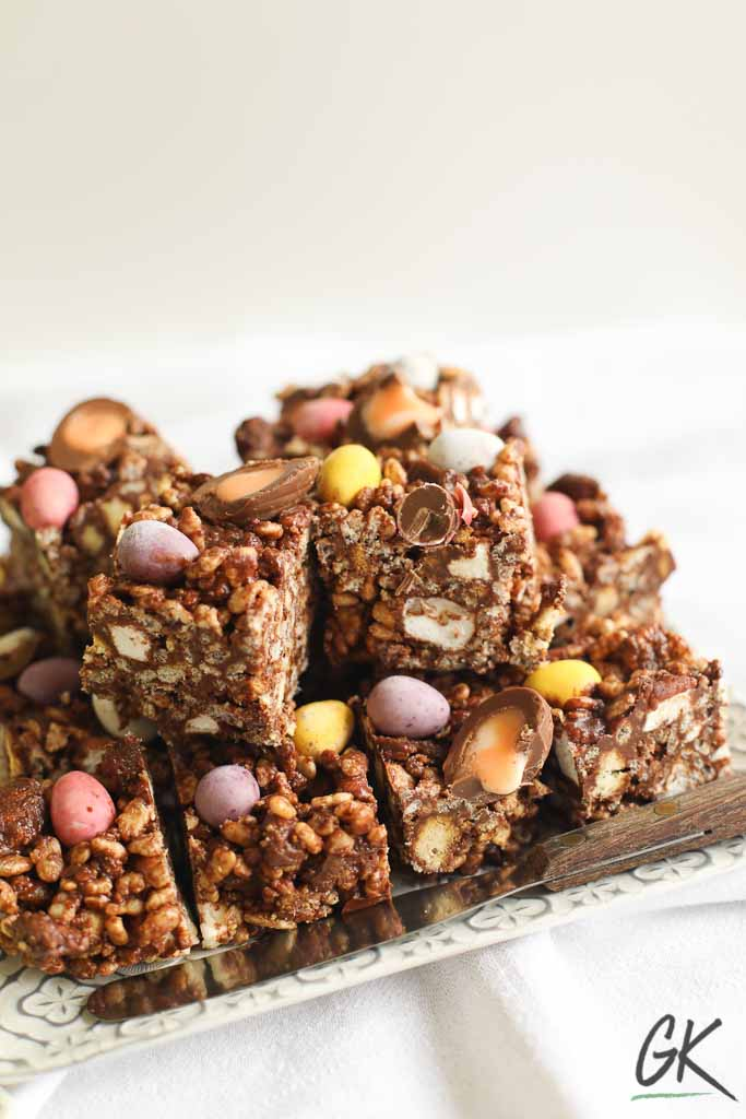 Chocolate Rice Crispy Fridge Cake sliced on plate from side