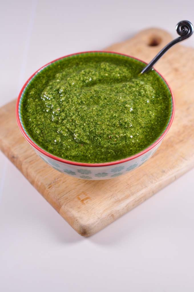 Kale pesto in a bowl with spoon