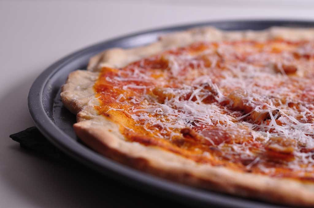 Pizza Amatriciana with guanciale and pecorino (landscape)