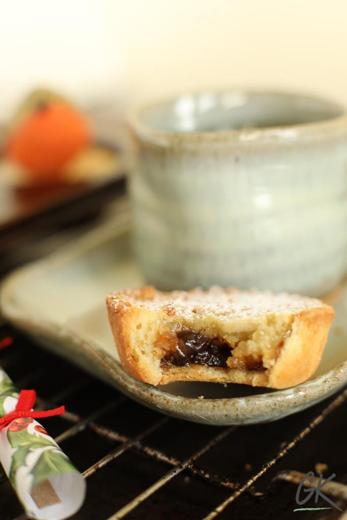 Frangipane Mince Pies on saucer with robin and cracker