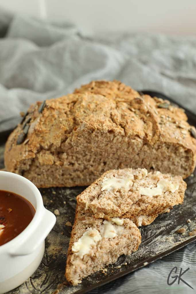 Traditional Irish Brown Soda Bread sliced with butter
