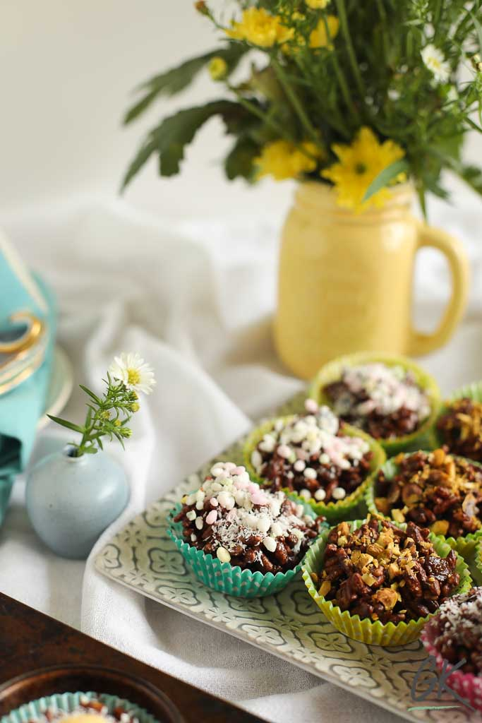 Healthier Chocolate Rice Crispy Fridge Cakes on plates with flowers