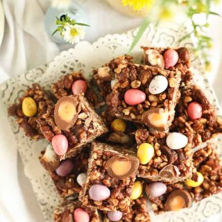 chocolate rice crispy fridge cake from above with flowers close