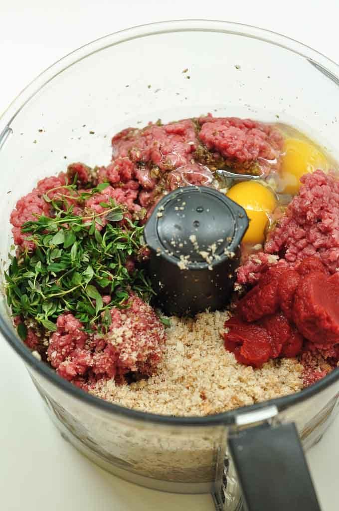homemade burgers raw ingredients in food processor